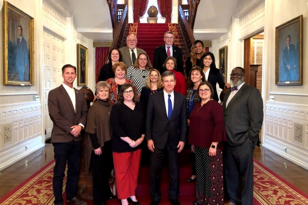 photo of Ed.D. students with Roy Cooper